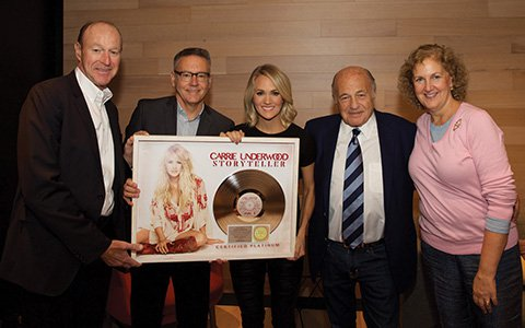 On the eve of her sold out Madison Square Garden concert on The Storyteller Tour – Stories in the Round, Carrie Underwood was surprised by Sony Music executives in New York when they presented a plaque commemorating the RIAA Platinum certification of her 19 Recordings/Arista Nashville Storyteller album.